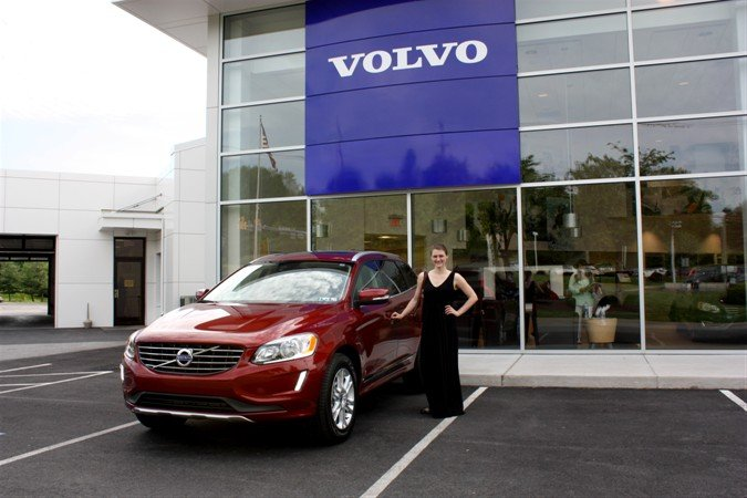 "Beth Davalos and Caitlin Lowry receiving their 2015 XC60s won during the ""Greatest Interception Ever"" campaign by Volvo Cars"